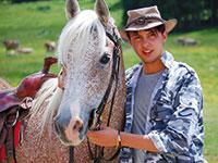 Cavallo e cavaliere al rifugio campolongo