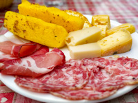 Inviting dish with polenta, cheese and cold cuts