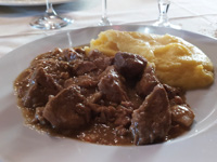 Porcini veal morsels with polenta