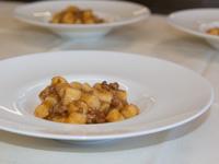 Homemade potato dumplings with meat sauce