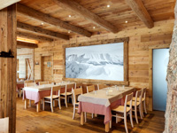 The warm wooden interior of the Val Formica restaurant
