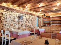 Restaurant room with wooden furnishings and walls