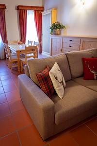 L'appartamento n°11 ha una spaziosa e luminosa zona living, con cucina e salotto