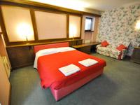 Camera superior con divanetto
