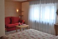 Quiete e comfort nella camera Primula, per un soggiorno di puro relax